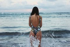 Woman standing in ocean waves Royalty Free Stock Images