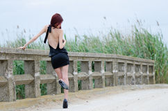 Woman is standing on a old cement bridge Royalty Free Stock Photo