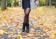Woman Standing On Alley Of City Park. Legs Closeup Royalty Free Stock Photo