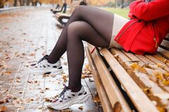 Woman Standing On Alley Of City Park. Legs Closeup Stock Images