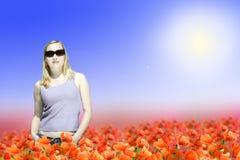 Woman Standing On Poppy Flowers Field