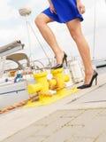 Woman standing one leg on marina bitt Royalty Free Stock Image