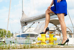 Woman standing one leg on marina bitt Stock Photos