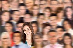 Woman standing out from a crowd Royalty Free Stock Photos