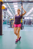 Woman standing out with a fitness straps Stock Image