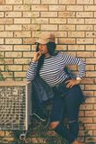 Woman Standing Beside Outdoor Ac Unit stock photo