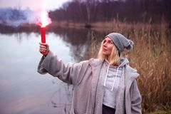Woman standing outdoors with burning torch Royalty Free Stock Photos
