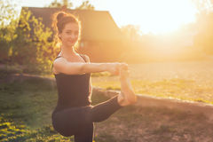Woman standing outdoors meditating in yoga position. Woman standing outdoors meditating in yoga position Stock Photos