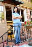 Woman standing outside bakery/cafe Royalty Free Stock Photos