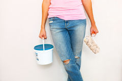 Woman standing with paint and brush Stock Photography