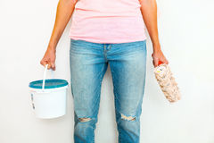 Woman standing with paint and brush Royalty Free Stock Images