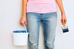 Woman standing with paint and brush Royalty Free Stock Image