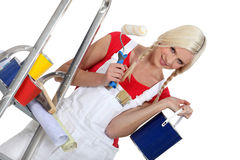 Woman standing with paint containers Royalty Free Stock Images