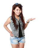 Woman standing with palm upwards. Portrait of smiling young woman showing a imaginary product on white background Royalty Free Stock Photo