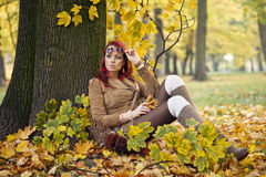 Woman standing in a park in autumn Stock Photos