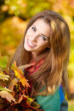 Woman standing in a park in autumn Stock Photography