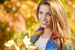 Woman standing in a park in autumn Stock Photo