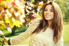 Woman standing in a park in autumn Royalty Free Stock Photography