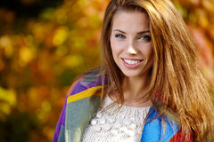 Woman standing in a park in autumn Royalty Free Stock Photos