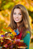 Woman standing in a park in autumn Stock Image