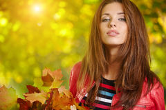 Woman standing in a park in autumn Royalty Free Stock Photo