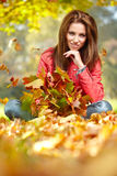 Woman standing in a park in autumn Royalty Free Stock Image
