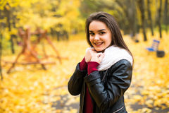 Woman standing in a park in autumn Royalty Free Stock Images