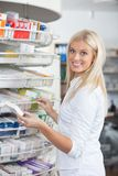 Woman Standing in Pharmacy Drugstore Royalty Free Stock Photos