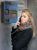 Woman standing at phonebox Stock Photo