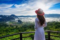 Woman standing on Phu Lang Ka, Phayao in Thailand.  stock photo
