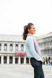 Woman standing on piazza san marco in venice Stock Images