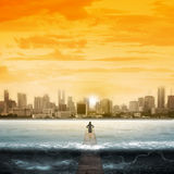 Woman Standing On The Pier Facing Waves Royalty Free Stock Photo