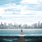 Woman Standing On The Pier Facing Waves Stock Image