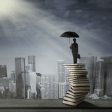Woman standing on a pile of books Royalty Free Stock Photo