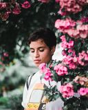 Woman Standing Beside Pink Petaled Flowers royalty free stock images