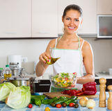 Woman standing  with plate of salad Royalty Free Stock Image