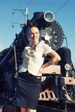 Woman standing on the platform near the retro train Stock Images
