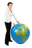 Woman standing and pointing at Europe on globe Stock Images