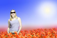 Woman standing on poppy flowers field Royalty Free Stock Photography