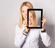 Woman standing with portable device in her hands Royalty Free Stock Image