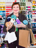 Woman is standing with purchases Stock Images