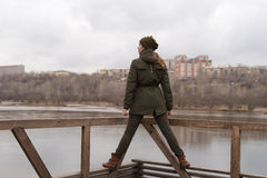 Woman standing on railing Royalty Free Stock Image