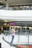 Woman Standing By Railing In Shopping Mall Stock Image