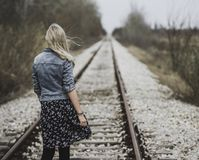 Woman Standing on Railroad Royalty Free Stock Image