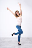 Woman standing with raised hands up Royalty Free Stock Image