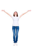 Woman standing with raised up hands. Happy young woman standing with raised up hands. full length portrait over white background Stock Photos