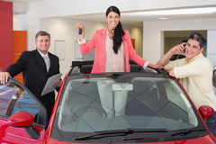 Woman standing in red cabriolet while holding her car key Royalty Free Stock Photos