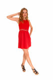 Woman standing in red dress. Royalty Free Stock Images