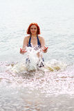 Woman standing in the river Stock Photography