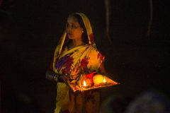 Woman standing in river water at chhat puja Stock Images
